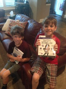 Noah and Zach showing off their new programming books
